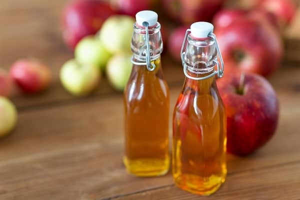 Glass bottles of apple cider vinegar